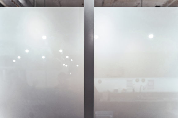 A cloudy white vinyl glass manifestation by Glyphics