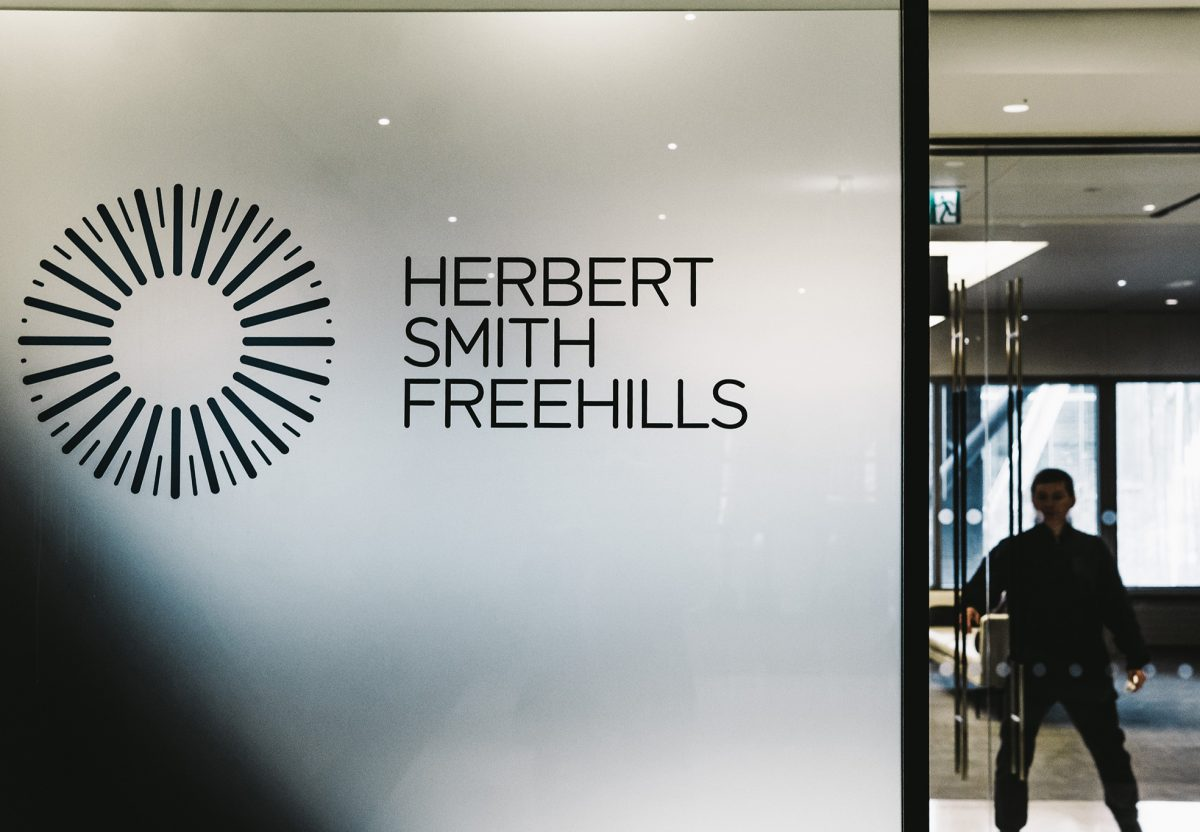 Close up of black Herbert Smith Freehills logo in frosted vinyl