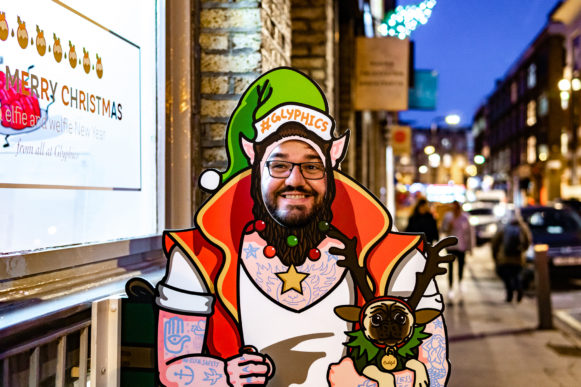 Close up of Russell inside the Christmas signage elfie.