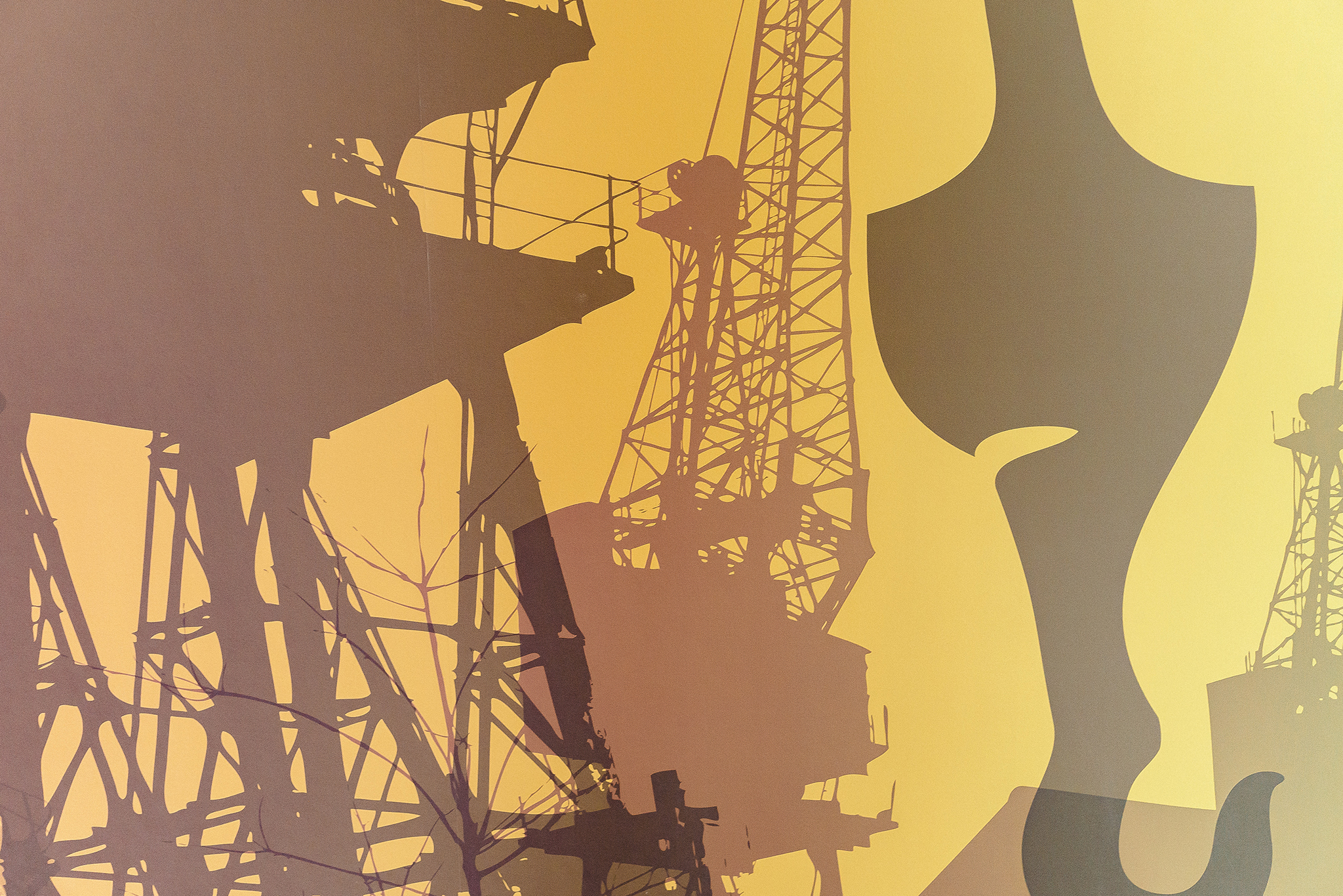 Yellow orange wallpaper with shadows of cranes.