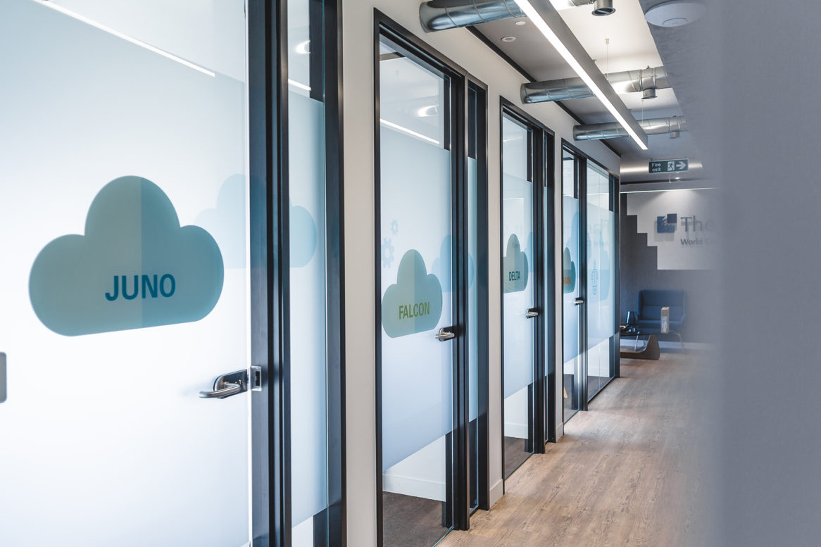 A frosted cloud on each of the meeting room doors.