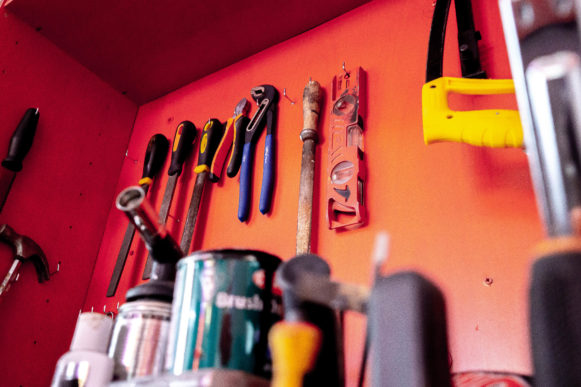 Red wall of tools in Jaison's studio.
